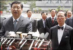 Xi Jinping and Donald Tsang
