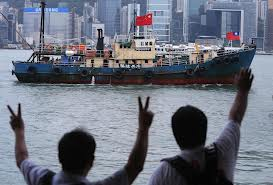 seven Hong Kongers sailing their fishing boat to the disputed island