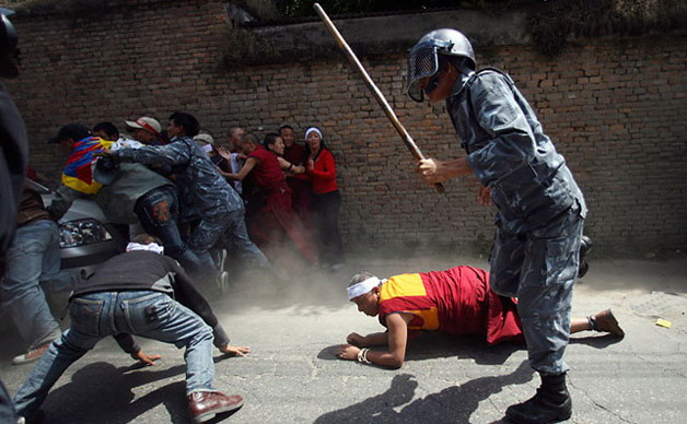 Tibetan monks were beaten by Chinese paramilitary servicemen